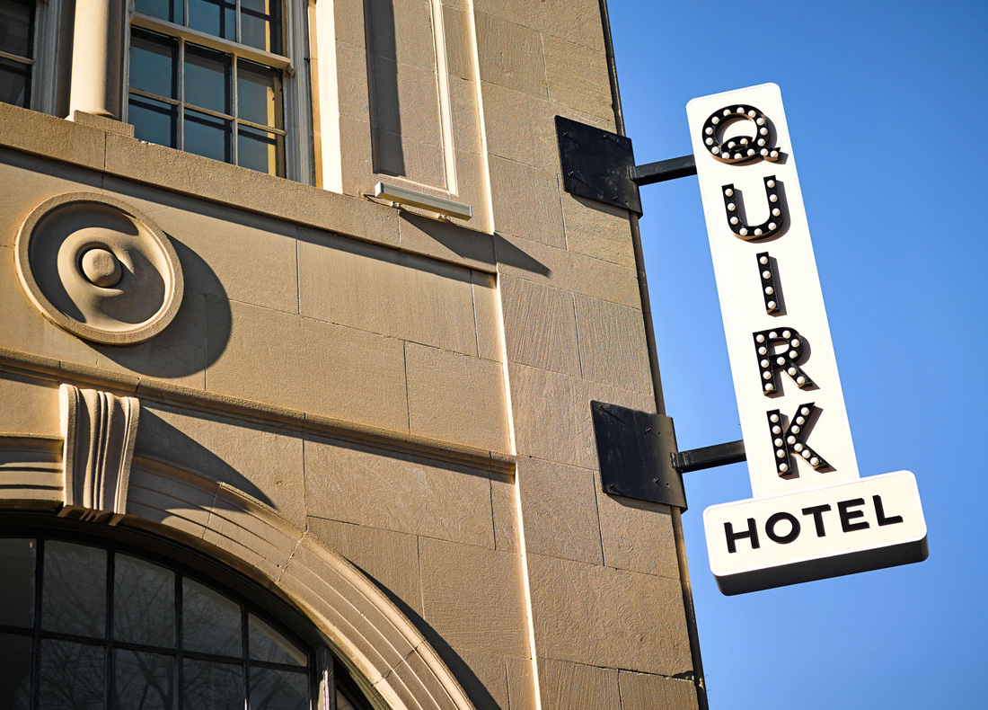 outdoor name sign with lights for Quirk Hotel in Richmond, Virginia, brand logo design in unique font