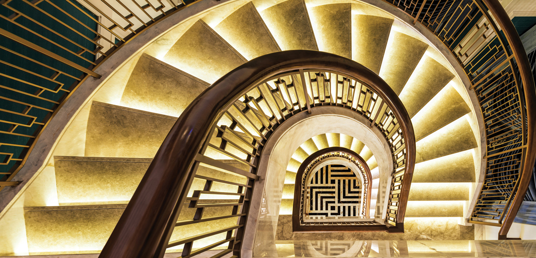 aerial view of luxury spiral staircase at Starwood St. Regis Hotels & Resorts property, immersive photography